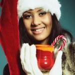 Winter girl santa helper hat holds red mug — Stock Photo #71559931