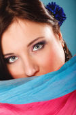 Woman makeup on eyes hiden her face with shawl — Stock Photo