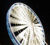 Ferris wheel at night  in Gdansk, Poland — Stockfoto