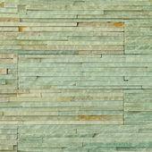 Green background of brick stone wall texture pattern — Stock Photo