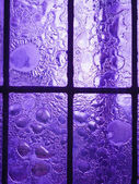 Stained glass window with regular block pattern — Stock Photo