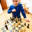 Little boy clever child playing chess thinking, — Stock Photo #71907349