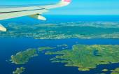 View from airplane flying over Norway. — Stock Photo