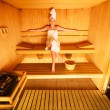 Woman sitting relaxed in  sauna — Stock Photo #72194059