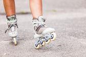 Part of human legs in inline skates — Foto de Stock