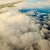 View from airplane flying in clouds. — Stock Photo