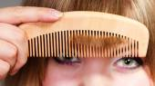 Woman combing her fringe — Stock Photo