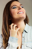 Woman scratching her neck — Stock Photo