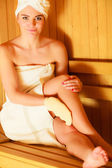 Woman relaxing in wooden sauna room — Stock Photo