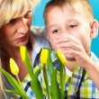 Child  giving flowers to his mom — Stock Photo #72476267