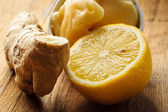 Ginger root, honey and lemon on wooden rustic table. — Stock Photo