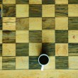 Chess table with glasses and coffee cup — Stock Photo #72633003