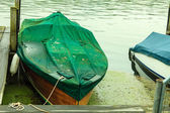 Fishing boat rowboat moored and floating at coast.  — Stock Photo