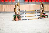 Yellow blue white obstacle for jumping horses. Riding competition. — Stock Photo