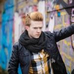 Fashion male portrait on graffiti wall — Stock Photo #72790343