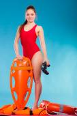 Lifeguard on duty holds binocular — Stock Photo
