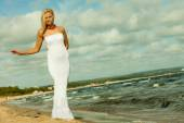 Beautiful blonde girl on beach — Stock Photo