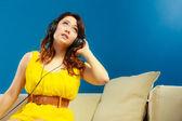 Girl in headphones listening to music — Stockfoto
