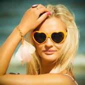 Beautiful blonde girl in sunglasses posing — Stock Photo
