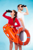 Lifeguards on duty looking through binoculars — Stock Photo
