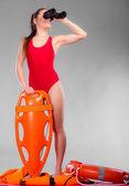 Lifeguard  holding equipment — Stock Photo