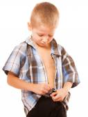 Little boy buttoning on shirt, isolated on white — Stock Photo