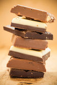 Stack of different sorts chocolate — Stock Photo