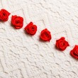 Frame of red silk roses on lace — Stock Photo #75363383