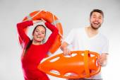 Lifeguard couple with rescue equipment — Stock Photo