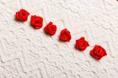 Frame of red silk roses on lace — Stock Photo