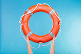Life buoy ring in female hands — Stock Photo