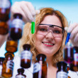 Woman holding test flasks — Foto de Stock   #75579067