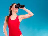 Lifeguard looking through binocular — Stock Photo