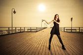 Woman posing on pier — Stock Photo