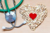 Oat flakes  and stethoscope. — Stock Photo