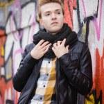Fashion male portrait on graffiti wall — Stock Photo #75975803