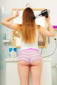 Long haired woman drying hair — Stock Photo