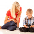 Mother and son playing video game on smartphone — Stock Photo #76727361