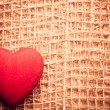 Red heart on abstract cloth background — Stock Photo #76727965