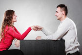 Male and female shaking hands — Stock Photo