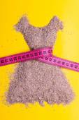 Dress shape made of cereal bran — Stock Photo