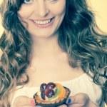 Woman holding fruit cake — Stock Photo #76822059