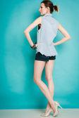 Girl in jeans shirt posing — Stock Photo