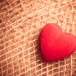 Red heart on abstract cloth background — Stock Photo #77028497