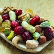 Varieties of dried fruits and nuts on wooden spoon. — Stock Photo #77165157