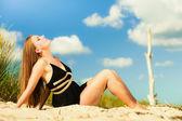 Woman sunbathing on beach. — Stock Photo