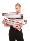 Business woman holding stack of folders — Stock Photo