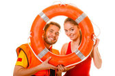 Lifeguards with ring buoy — Stock Photo