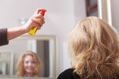 Young woman in hairdressing beauty salon — Stock Photo