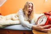 Woman waking up late — Stock Photo